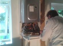 gas safe boiler   engineer fitting new position combi boiler