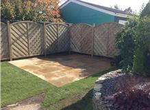 FENCING AND PATIO LAYING TO END OF REAR GARDEN.