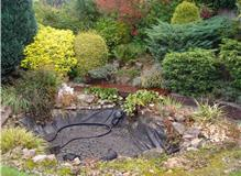 Filling in a garden pond and returfing.  Building a garden wall and patio area.