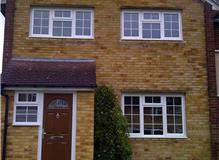 9 windows, 2 doors removal of concrete sills and replacing with brickwork.