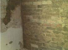 Dead plaster removed from walls prior to replastering and tiling