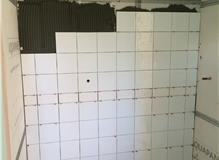 Kitchen, bathrooms and floor tiling done.