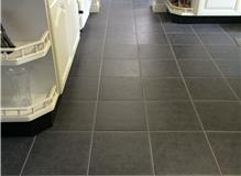 Utility room floor tiled