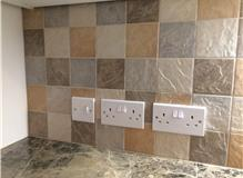 Tiled splashback in kitchen.