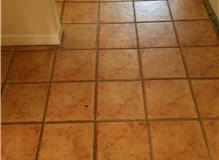 Laid Tumbled Marble floor tiles in the hallway and through to dining room.