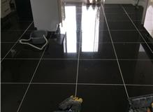 Levelled and tiled kitchen floor. Splash back tiled.
