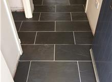 Tiling kitchen and hallway with slate tiles.