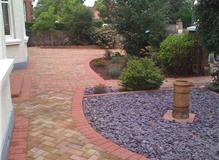 Herringbone block paving and boarders