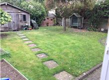 Verdi Sandstone with stock brick planters and lawn