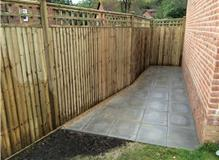 New fencing and utility paving for shed
