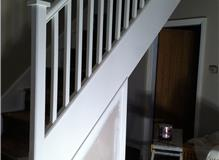 Stairs Woodwork repainted by Johnson and Partners