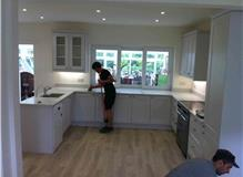 Break out wall, close doorway design, supply and install new kitchen.