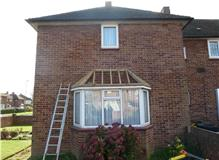 Replacement of bay window, flat roof to a pitched in Ashford.