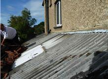 Remove old roof to side and rear extension.