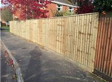 Remove old fence and replace with concrete posts and gravel boards.