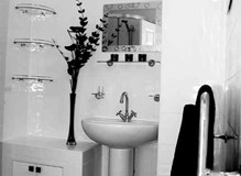 bathroom wit shower pump cupboard