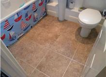 Screed bathroom floor fit karndean tiles.