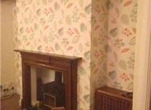 Redecoration of the sitting room wallpaper and painting.