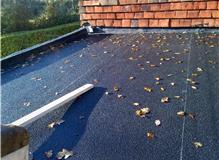 Repair and relaying of flat roof.