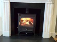 Removal of gascoal fire basket.  Install new wood burning stove with flue liner and insulation.   R