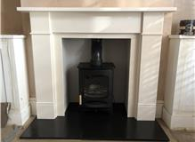 Charnwood C4 with Fireboard Opening and Limestone Surround (Flat Victorian Style)