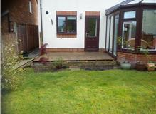 installation of patio, retaining wall and fence panels