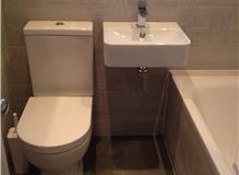 Complete bathroom refit, including removal of old tiles and bathroom fittings. London SW19