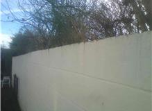 To increase height of existing block wall by two courses.