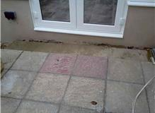 To install pathway in front of conservatory, replace fence panel and build step.