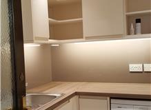 Modern utility gloss cream units with mocha Alu spashback new led lighting