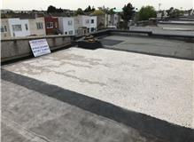 New 3 layer felt flat roof with heat reflective limestone chipping bonded to felt surface.