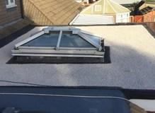 3 layer hot bitumen felt flat roof with heat reflective limestone chipping finish.
