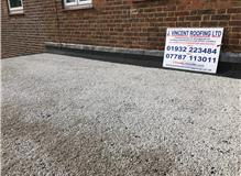 New 3 layer felt flat roof with heat reflective limestone chipping bonded to felt surface, new lead