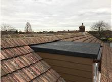 New 3 layer felt flat roof, Hardie Plank Cladding & Ridge tiles relaid