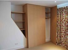 Painting of fitted wardrobes and shelves