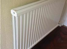 Complete new central heating system and radiators including resiting boiler.