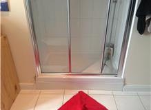Cracked shower tray replacement.