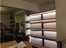 Existing shelves, we've installed wood coloured aluminium profile and given the customer a wireless
