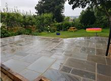 Large patio area in buff mix Indian Sandstone.