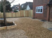 Fencing, shingle and sleeper border edging.