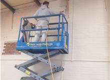 Spray painting a large Unit in Andover