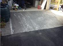 Resin bound driveway covering concrete with 'silver grey'