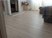 Took boards back to bare wood then white wash and varnished floor