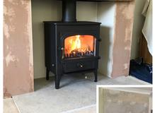 "Clearview Vision 500 on 6"" legs, limestone hearth, composite oak effect beam, smooth internal boardi"