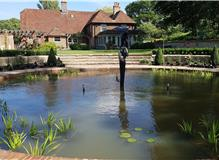 Formal pond with sculpture for country garden near Battle, East Sussex