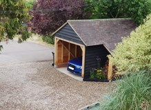 Single bay garage with log store