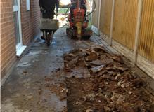 Block Paving prep. Removing concrete.
