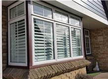 Box bay plantation shutters with from outside The Great Shutter Co.