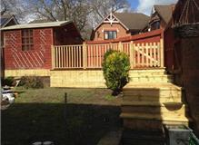 New raised decking area with hand rail and gate installed by Outback Landscapes