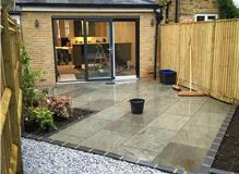 Grey Sandstone with Brick Edging and Ice Blue Stone